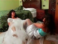 Brides have a catfight in the bedroom