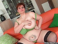 Old BBW with monumental chest fucks a long dildo