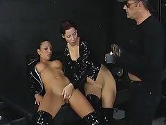 3some in the dungeon space with black latex ladies