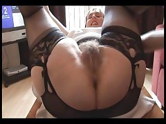 Fur covered busty mature dame in slip and girdle does upskirt and